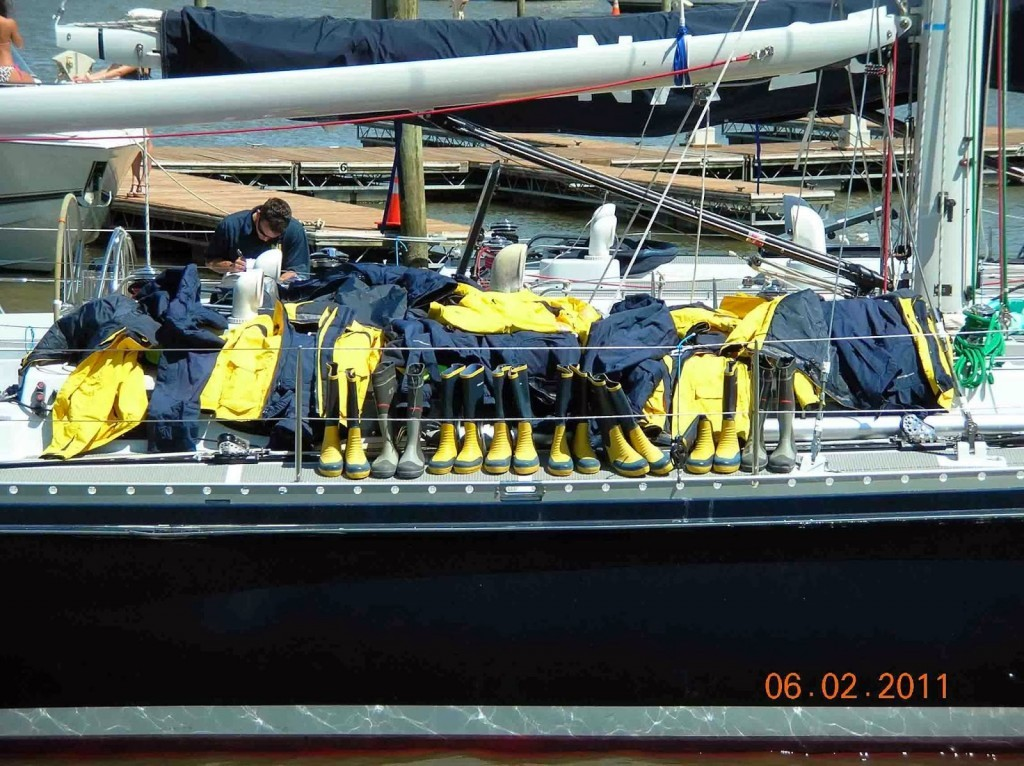 Sailboat with safety gear and boots lined up on the deck