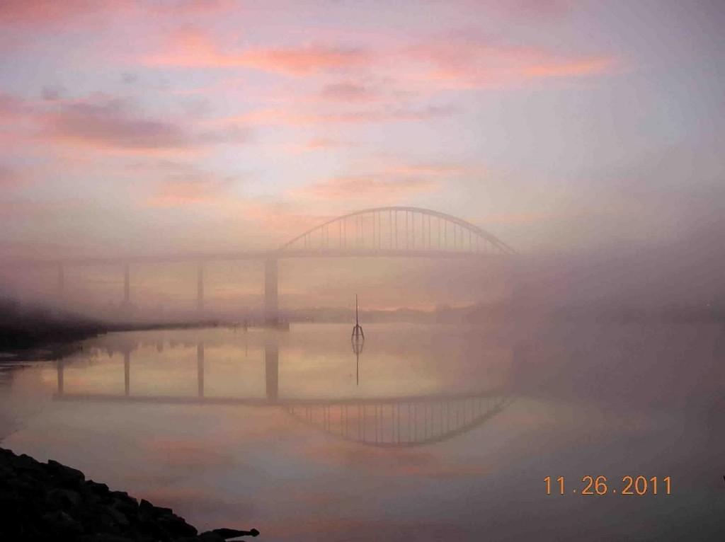 The bridge at sunrise on a foggy morning