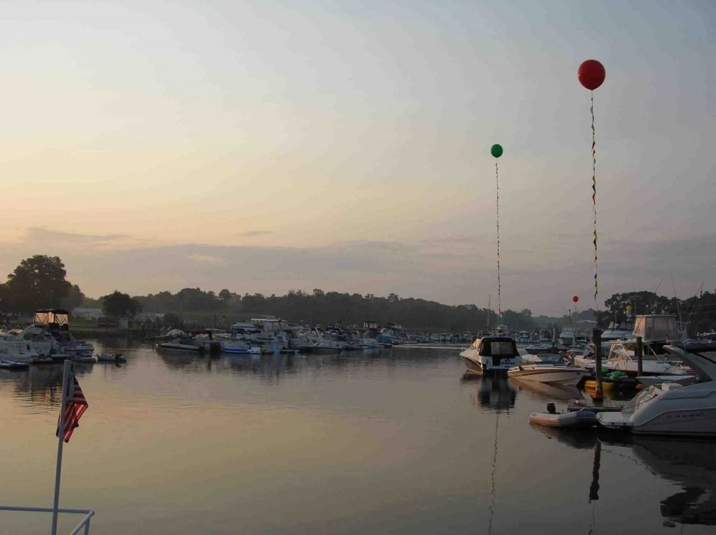 Boats in marina with helium balloons