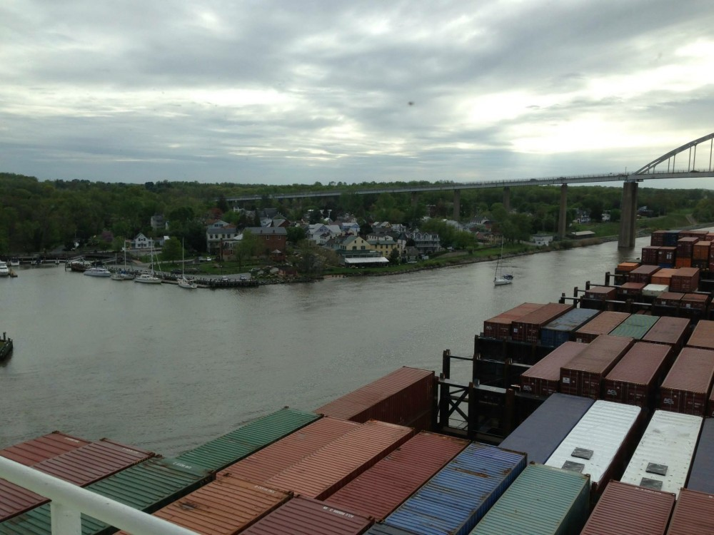 The harbor as seen from a freighter with cargo containers covering its deck