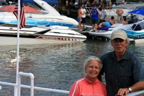 Couple pose for camera along water during Canal Day