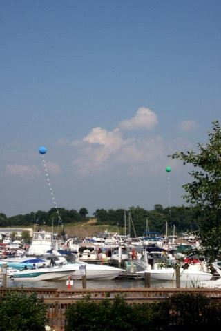 Canal Day with balloons in basin amongst the boats