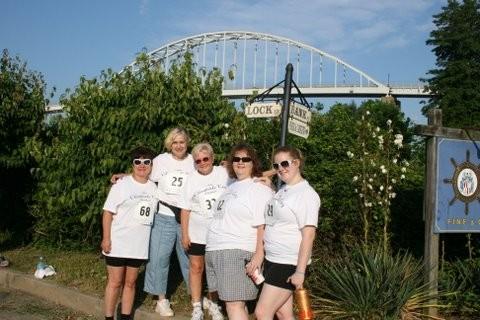 Group of 5 female runners posing for 5k run