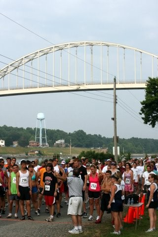 Runners congregating below the bridge of Canal Day 5K Run/Walk