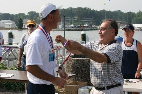 Winner of Canal Day 5K Run/Walk being awarded ribbon