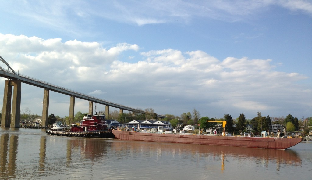 Tug boat pushing a barge through the canal